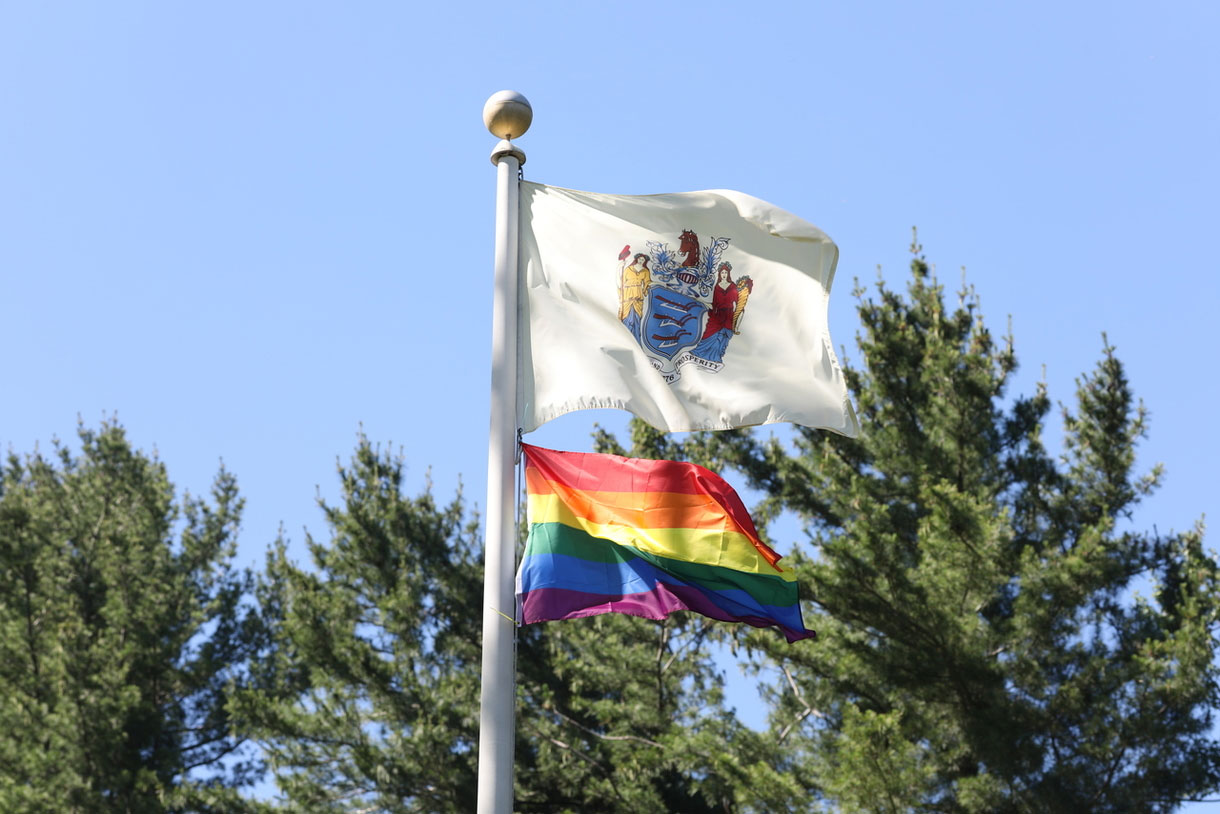 Photo contains: New Jersey State Flad and Pride Flag